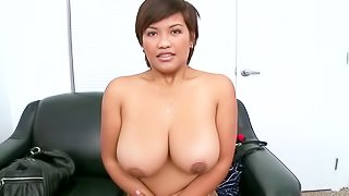 Amateur sexy Reina is very proud of her huge natural boobs. This first timer poses naked on camera eagerly. She touches her wet massive titties and then exposes her smooth pussy