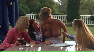 Four big tits lesbians strip nude and suck tits