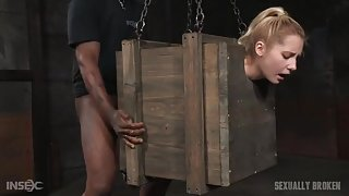Slut in a bondage box fucked by big dicks