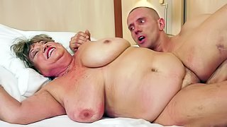 Margitta is a fat sex obsessed granny with massive tits. She gets her twat drilled by rock stiff young cock and gives head. This chubby mature slut cant get enough. Watch her fuck like crazy