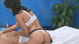 Raven haired massage girl Bailey wears sexy white lingerie. Brunette chick in white bra and panties exposes her lovely ass while giving massage