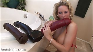 Busty milf squirting from a huge dildo