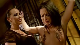 Tied up brunette babe with natural boobies and arousing make up gets tortured and disciplined by experienced brunette milf with ponytail in black sexy dress in provocative bondage fantasy filmed in close up