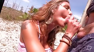 Gorgeous and tattooed tanned blonde gets picked up by horny lad and enjoys in giving her cock sucking skills to him on her knees in front of the cam by the car