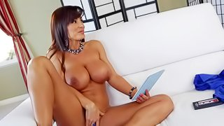Hot MILF Lisa Ann is sex hungry. She strips down to her bare skin while watching porn on the couch in the living room. Hot woman with massive boobs and bubble ass strokes her trimmed pussy. Lexington Steele is the one who catches her masturbating