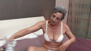 Granny strips to her white panties in bed