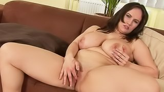 Dark haired mature brunette Olarita with massive natural tits strips out of her white bra and panties before posing totally naked and masturbating. Plump Olarita shows every inch of her body and fingers her slit