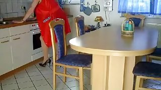 Busty German milf gets fucked on the kitchen table