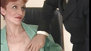 Thin, Short Haired Redhead Banged In The Office