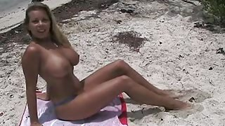 Beautiful blonde with big boobs fucked in the beach