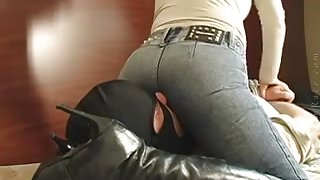 Amateur girl sits on face of slave, while in jeans