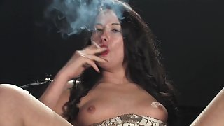 Cody smokes corks whilst fucking herself with a huge dildo