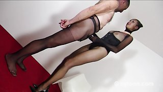 Gia in nylon encasement uses villein as a thong-on sex-toy toy