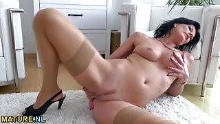 Milf home from work and stripping to masturbate erotically