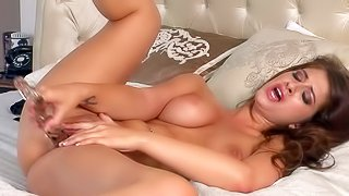 Karina White is a passionate dark haired babe with sexy big boobs and long legs. Nude babe drills her wet snatch like crazy with her new glass dildo in the middle of the bed. Watch and enjoy!