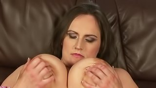 Chubby attractive mature brunette Olarita with big sized tits shows off her killer assets. She licks and rubs her huge natural juggs before she strips out of her dress and bra