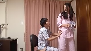 A dude begs his long-haired Japanese wife to give him a handjob