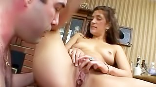 Young looking amateur brunette babe with nice natural boobs and long legs gets her shaved pussy licked by her lover and gets pounded from behind all over the living room
