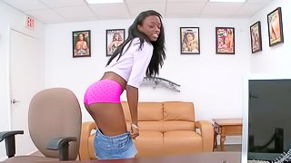Sexy ebony teen babe in her short denim skirt and undies enjoys in stripping and showing her shaved taco and boobs in front of the camera on her casting session