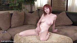 Pretty redhead shakes her booty in panties