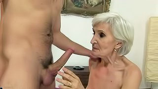 Cock hungry short haired blonde granny with sexy make up in stockings only gives head to young horny pool boy and gets his rock hard pecker deep in her hairy cunt in living room