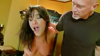 Naked submissive brunette Charley Chase with natural tits gets her bare as seriously spanked by men and women in the middle of the room. Then she gets her face fucked by several hard dicks at once